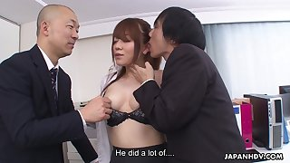 A talented secretary has naughty sex with two men in an office