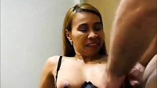 Mature Asian takes a load on her pair