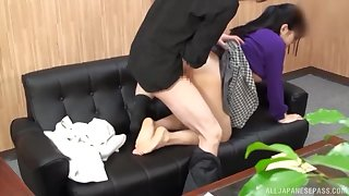 Japanese lifts up her skirt for a nice doggy on burnish apply couch
